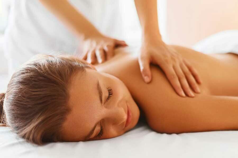 woman enjoying massage in queenstown spa South Island travel deals